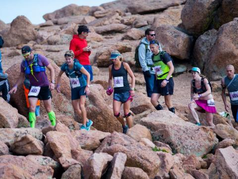 Athletes race up the mountain in the Pikes Peak Ascent and Marathon