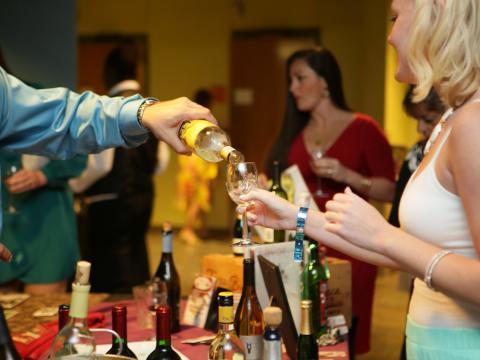 Sampling wine during the SeaGrapes Fine Wine & Food Festival at The Florida Aquarium in Tampa, Florida